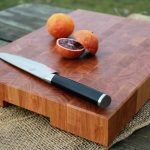 Cherry butcher block with oranges and chef's knife
